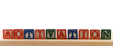 Motivation. The word motivation spelled using colored baby letter blocks, isolated against a white background Stock Photography