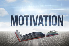 Motivation against open book against sky Stock Photo