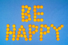 Motivation: Be happy. Be Happy, motivation quote. Letteras are mde of little yellow round on blue background stock photo