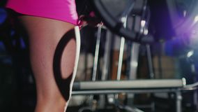 Motivation and commitment to the sport: athletic woman training in a hall in gym. Closeup. Motivation and commitment to the sport: athletic woman training in stock video footage