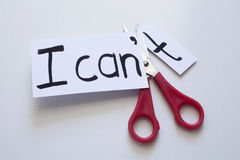 Motivation concept. With I can`t phrase cut into I can Royalty Free Stock Images