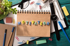 Motivation concept. Letters on the desk Stock Photos