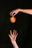 Motivation. Hand trying to get apple Stock Images