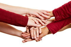 Motivation and help with many hands. On a stack stock image