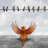 Motivation And Imagination. Concept as an ambitious cat with imaginary wings looking up at a group of birds as an aspiration  metaphor for planning creative Royalty Free Stock Photography