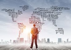 Motivation and inspiration concept with modern cityscape and businessman observing it. Businessman standing with back and looking at global business concept Royalty Free Stock Images