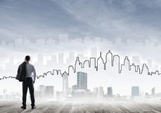 Motivation and inspiration concept with modern cityscape and businessman observing it Stock Image