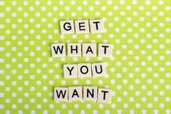 Inspirational sentence formed with game tiles. Motivation and inspiration related sentence formed with game tile letters stock photography