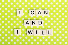 Inspirational sentence formed with game tiles. Motivation and inspiration related sentence formed with game tile letters royalty free stock images
