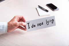 Motivation. A man holding a sign with the text, for motivation Royalty Free Stock Image