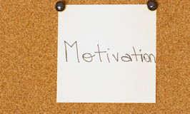 Motivation post-it on a coarkboard background Royalty Free Stock Photo