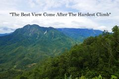 Motivation quote The Best View Come After The Hardest Climb with mountain and blue sky view. royalty free stock image