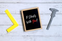 Motivation quotes It Starts With You! on a blackboard. Business and finance concept. royalty free stock images