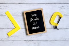 Motivation quotes Work Smarter Not Harder on a blackboard. Business and finance concept. Motivation quotes Work Smarter Not Harder on a blackboard. Business and stock image