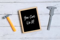 Motivation quotes You Can Do It! on a blackboard. Business and finance concept. stock image