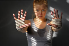 Motivation of sports. Female athlete stretching forward sweaty, dirty hands. Motivation of sports Royalty Free Stock Photos