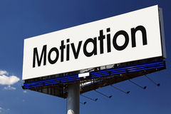 Motivation word on billboard. Royalty Free Stock Photography