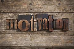 Motivation written with letterpress type Stock Images