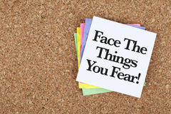 Motivational Encouragement Message Face The Things You Fear. Inspirational phrase note about fear, Supportive background stock photo