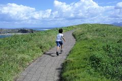 Motivational or inspirational concept Kid running up the hill stock images