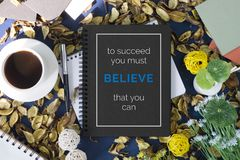 Notebook with motivational quote. Motivational and inspirational quote. Business Quote. Minimal flat lay top view concept Stock Images