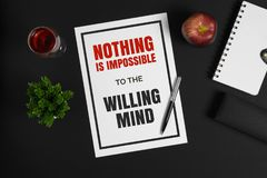 Paper with motivational quote on black background. Motivational and inspirational quote. Self help and improvement wisdom quote Stock Photos