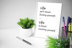 Notebook with motivational quote. Motivational and inspirational quote. Wisdom quote about life. Notebook with potted plant Stock Photography
