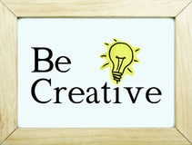 Motivational phrase be creative. Be creative phrase note with light bulb Stock Images