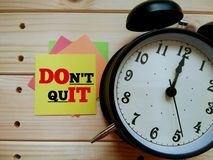 Motivational quote `Don`t Quit` on sticky color note. royalty free stock photography
