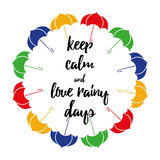 Motivational quote about rain decorated colorful umbrellas on white. Autumn and rain motivational quote with colorful umbrellas on white. Brush hand lettering Stock Images