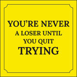 Motivational quote. Youre never a loser until you quit trying. Stock Photography