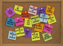 Motivational reminders on bulletin board. Motivational slogans and phrases - colorful reminder notes with handwriting on cork bulletin board Royalty Free Stock Image