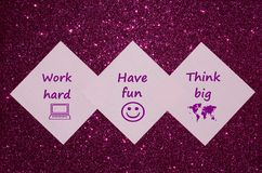 Motivational text on purple glitter background Royalty Free Stock Photos