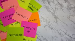 Motivational words on colorful stickers on a marble table. Business plan, strategy, concept, future. Copy space, creativity, stock images