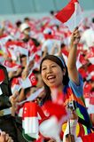 Motivator waving Singapore flag during NDP 2009 Stock Image