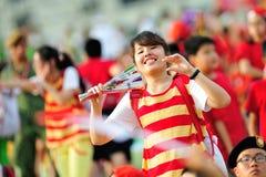 Motivatore che esegue durante la ripetizione 2013 di parata di festa nazionale (NDP) Fotografie Stock Libere da Diritti