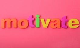Motiveer woord op achtergrond stock afbeeldingen
