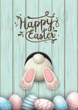 Motivo de Pascua, parte inferior del conejito y huevos de Pascua en hierba fresca en el fondo de madera azul, ejemplo ilustración del vector
