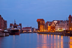 Motlawa码头和老格但斯克在晚上 免版税库存照片