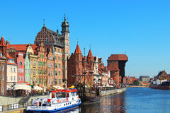 Motlawa river embankment in downtown Gdansk. GDANSK, POLAND - JULY 27, 2012: Historic buildings on the bank of Motlawa river in downtown Gdansk Stock Photo