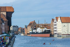 Motlawa River Gdansk. Motlawa River with the medieval port crane to the left and the National Maritime museum and mueum steam ship Soldek. Gdansk, Poland Royalty Free Stock Image