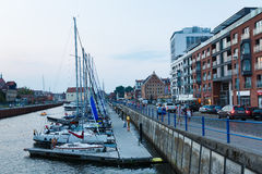 Motlawa riverside in Gdansk. Gdansk, Poland - August 08 2015: View of Motlawa riverside and Marina Club Hotel at the evening time Royalty Free Stock Photos
