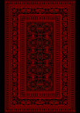 Motley carpet with a red pattern on a black background Royalty Free Stock Photo