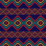 Motley color ethnic seamless knitted pattern. Motley ethnic background in blue, red, orange and turquoise colours, seamless knitting vector pattern as a fabric Stock Photo