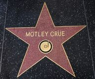 Motley Crue star on the Walk of Fame. HOLLYWOOD,CA - DECEMBER 19, 2013: Motley Crue tribute on the Walk of Fame. This star is located on Hollywood Blvd. and is Royalty Free Stock Images