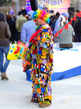 Motley funnyman. Motley clown at Varna Carnival venue held  on March 26th,2016,Bulgaria Royalty Free Stock Photos