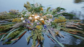 A motley grass wreath on the water stock footage