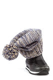 Motley knitted hat or cap and black boots Royalty Free Stock Photos