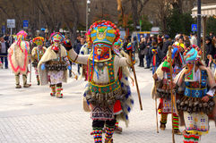 Motley mummers carnival procession. Kukeri dressed in richly decorated costumes at Varna Carnival street procession held  on March 26th,2016,Bulgaria.Kukeri are Royalty Free Stock Photography