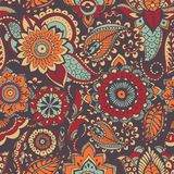 Motley oriental paisley seamless pattern with colorful buta motif and mehndi elements on dark background. Bright colored. Vector illustration for fabric print stock illustration
